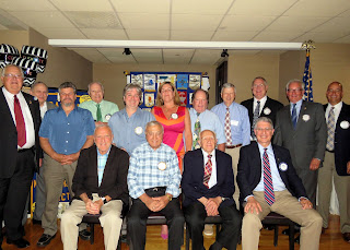 Franklin Rotary Club recently hosted a reunion of Past Presidents. In the photo are (Seated, L to R) Robert Vallee, John Padula, Victor Pisini, and Frank Cussano, and (Standing, L to R) Dan Gentile, Dr William Koplin, Archie Acevedo, Edward Hick, Francis McKeowen, Julie Rougeau, Steven Crowley, Bruce Healey, Gary Mccarraher, Dr Jeffrey Morrill, and Richard Cornetta