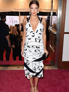 Riley Keough in a black and white Proenza Schouler midi dress with ruffle details at the 2016 CFDA Fashion Awards
