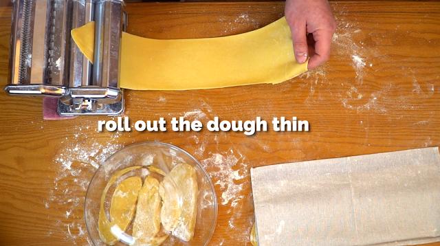 thinning the dough to make ravioli