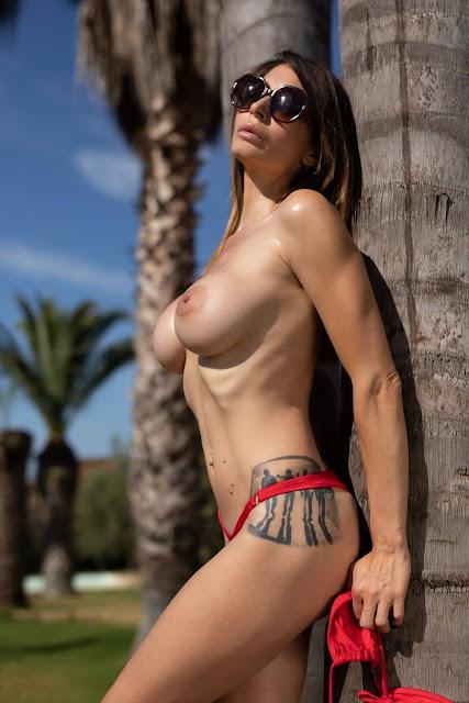 topless model with big tits in sexy bikini