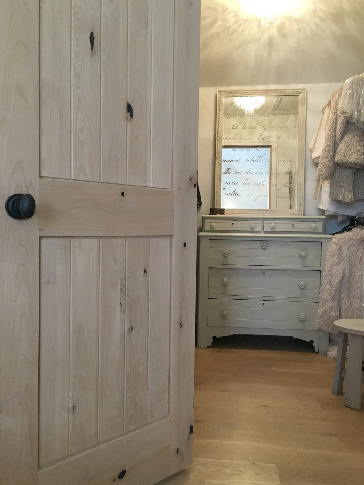 dressing room closet with knotty alder door by Pacific Entries in Hello Lovely Studio fixer upper