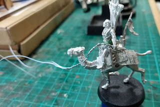 Converting some reigns onto a camel rider
