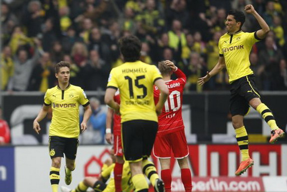Dortmund player Nuri Şahin celebrates after scoring a goal against Fortuna Düsseldorf