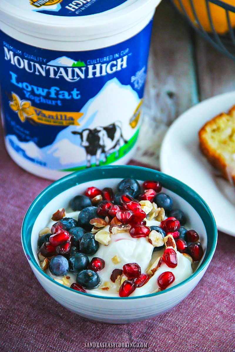 SNACK OR BREAKFAST: Delicious Mountain High Yoghurt (Vanilla Flavor), pomegranate, blueberries, hazelnuts