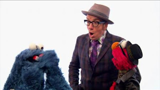 Elvis Costello and Elmo sing A Monster Went and Ate My Red Two (cookie monster), Sesame Street Episode 4408 Mi Amiguita Rosita season 44