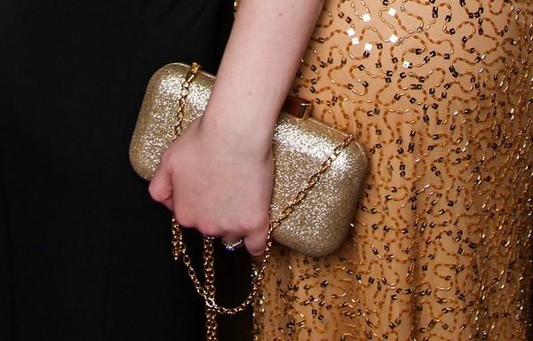 Sac à main doré, accessoire mode pour robe de soirée
