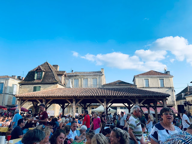 The market square in Beaumont, Dordogne during the night market in August