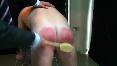 Brad takes a hard spanking in a gay spanking video produced by No Way Out Punishment