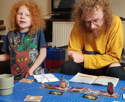 Trapwords gameplay in action man guessing words by listening to clues given by child