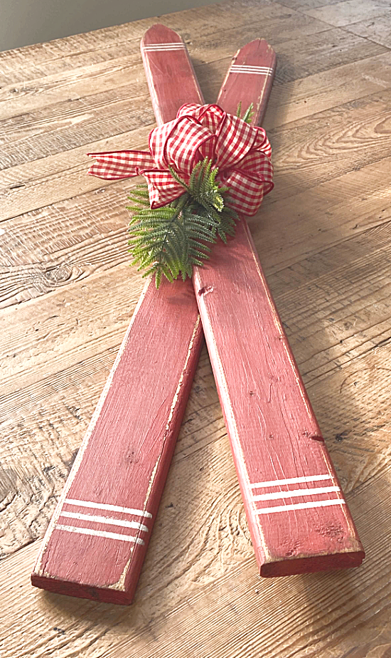decorative red skis on a table