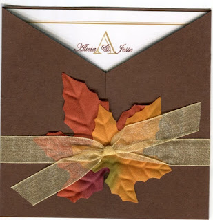 a fall brown square wedding invitation with silk leaves