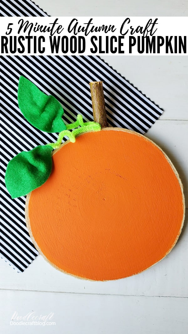 Pumpkins are the perfect symbol of Autumn. This rustic wood slice pumpkin is the perfect Fall craft DIY and just takes 5 minutes to complete!   This cute pumpkin can sit on the mantle with Autumn decor. Attach it to a wreath for the perfect front door decor. If you want to make it perfect for Halloween, get some black paint and give it a Jack-o-lantern face.