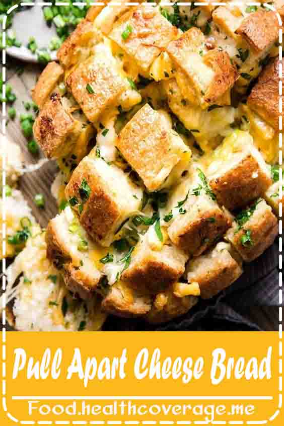 Pale green speckles of green onion and parsley brighten molten rivers of garlicky cheddar and mozzarella cheese that's been melted over a loaf of country bread in this easy Tillamook pull-apart cheese bread recipe.