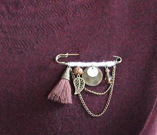 tassel brooch