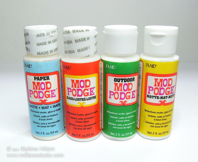 4 bottles of different types of Mod Podge