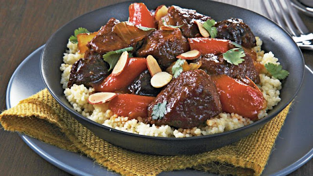 Bring the flavors of Africa to your dinner table with this slow cooked lamb tagine Slow-Cooker Spiced Lamb Tagine Recipe