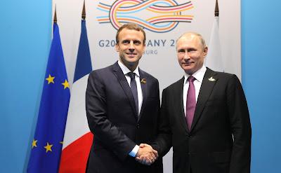 Vladimir Putin, Emmanuel Macron.
