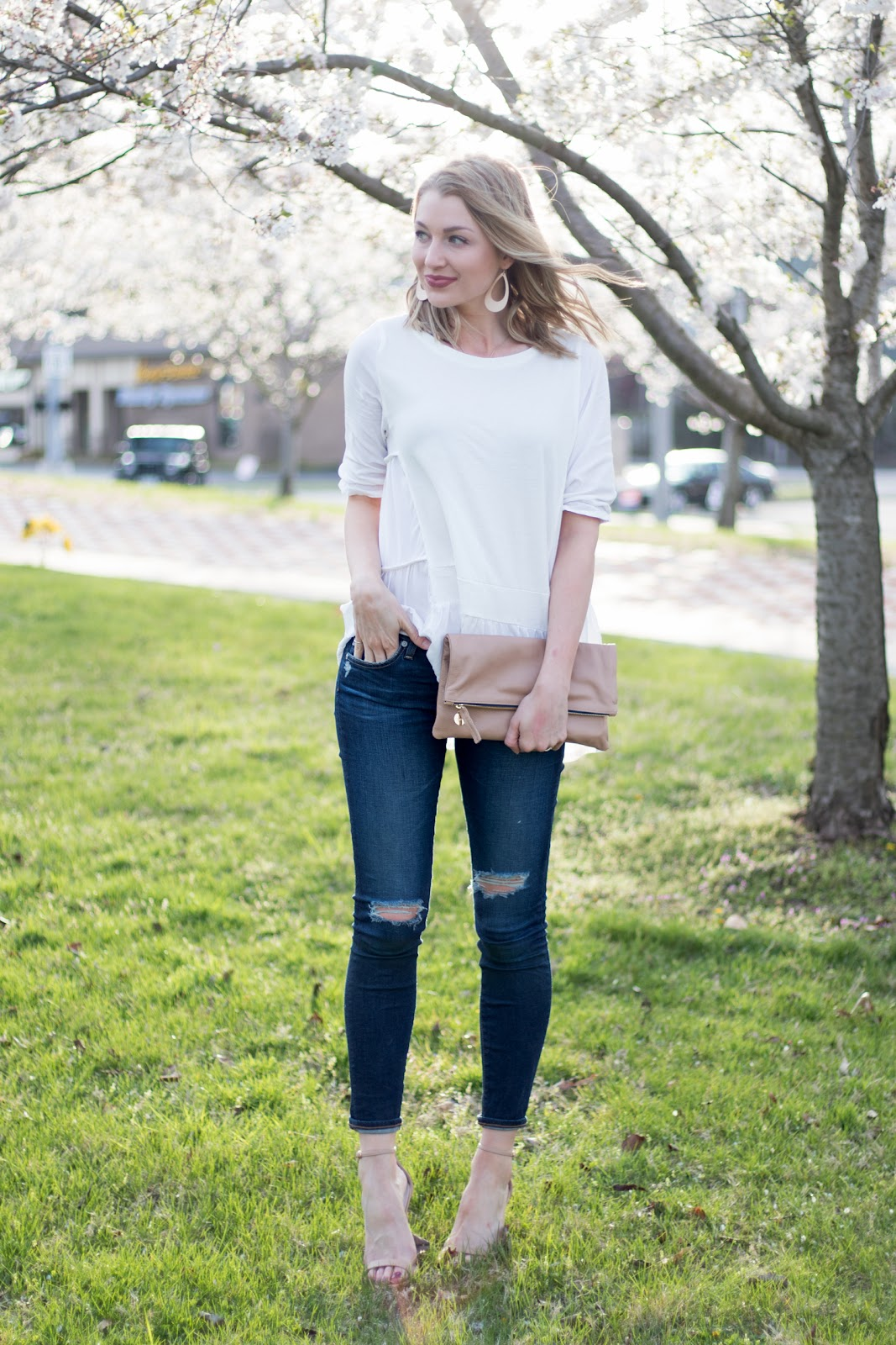 White top + distressed denim for spring