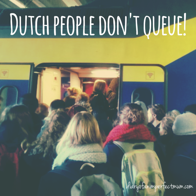 Dutch people don't queue - people crowding around the train