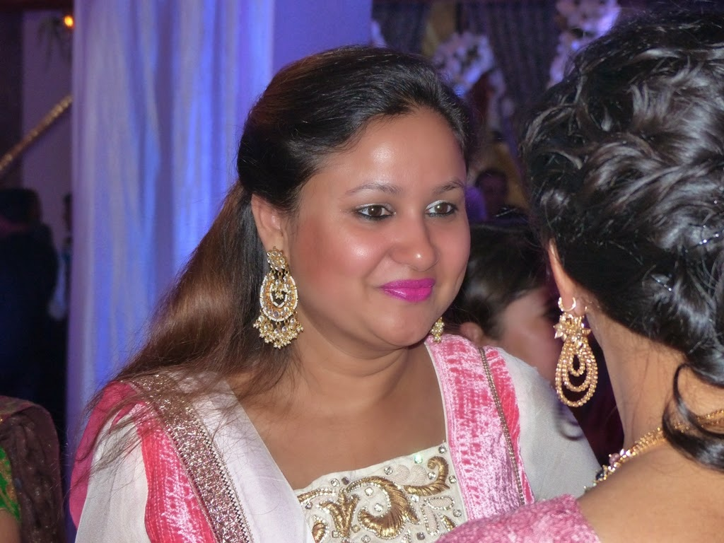 Indian women wearing large earrings