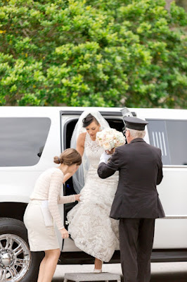 wedding coordinator helping bride out of limo