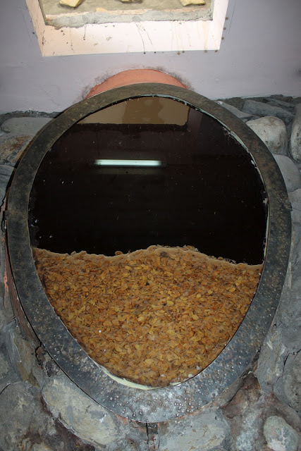 Wine naturally ferments and filtrates in a kvevri.