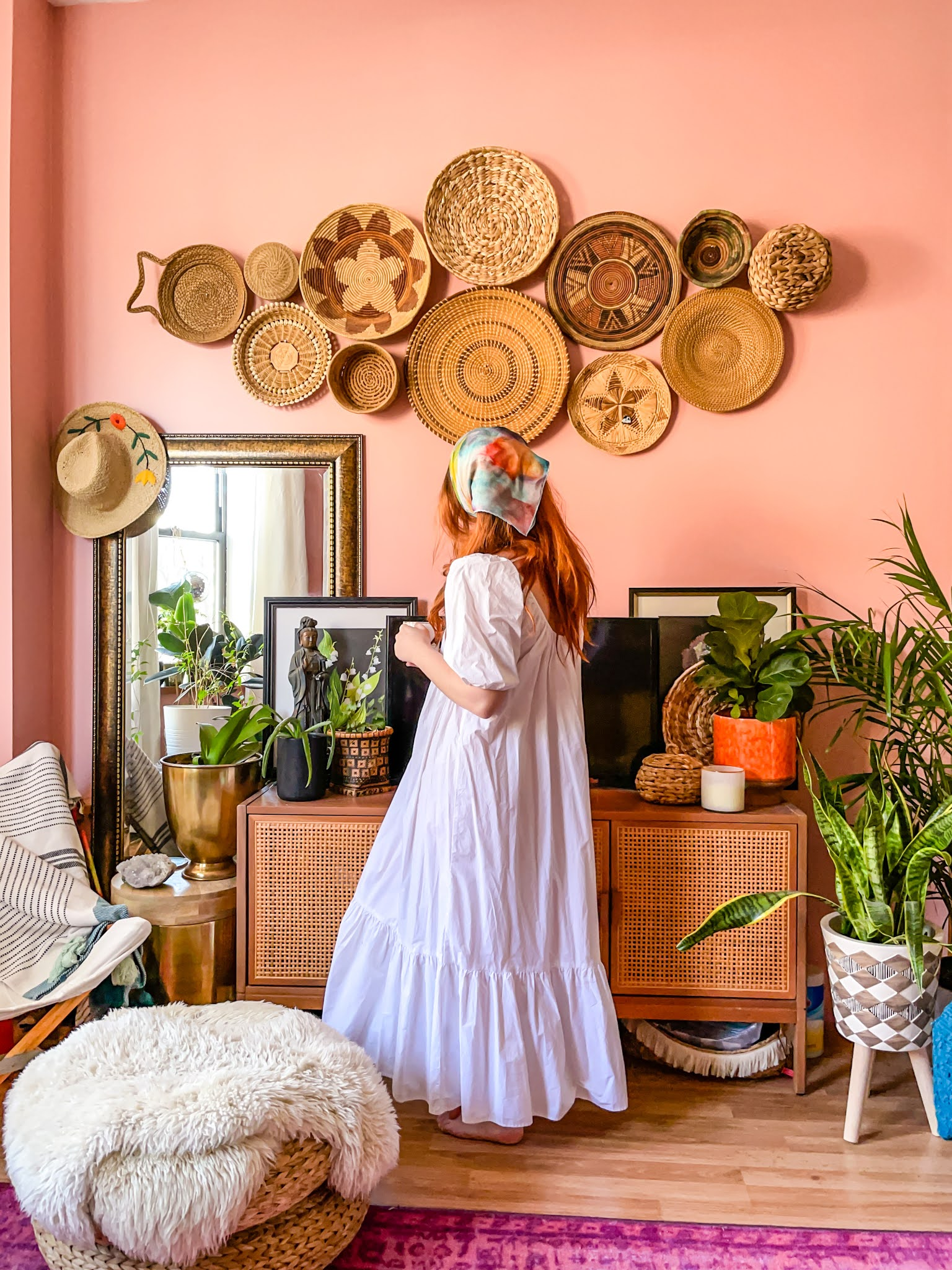 colorful rooms // pink room // pink decor // basket wall inspo // basket wall inspo // colorful planters // plant homes // pink living room // living room with plants // opal house media stand // rattan furniture