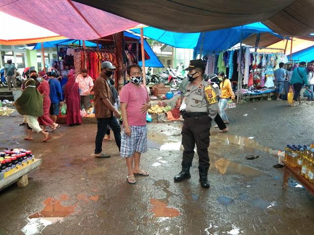 Kapolsek Marioriwawo Sosialisasikan New Normal Ke Pengunjung Pasar