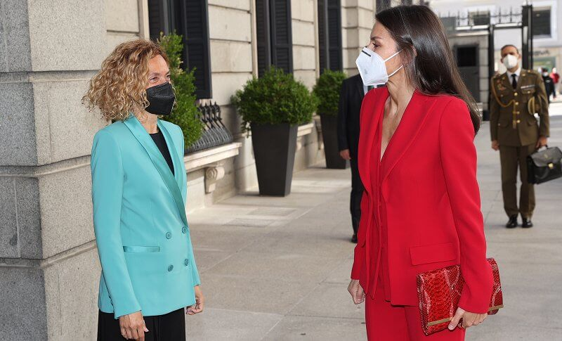 Queen Letizia wore a two-piece red suit by Spanish fashion designer Roberto Torretta