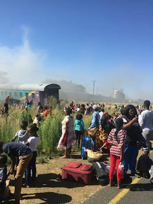 Photos: Collision between a train, truck and a car leaves at least 20 dead, 260 injured in South Africa