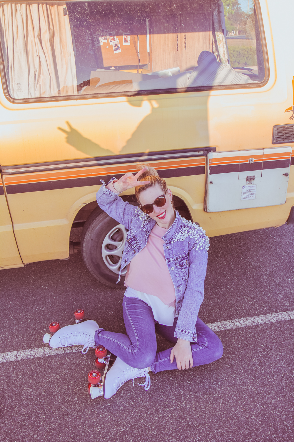Goldfields Girl sits in front of my van with her rollerskates on. My shadow is on her in the bright sun.