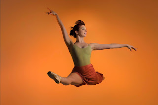 A Ballerina and Dance Model in a Graceful Leap