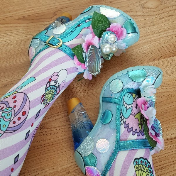 Irregular Choice mermaid inspired shell and pearl shoes on feet