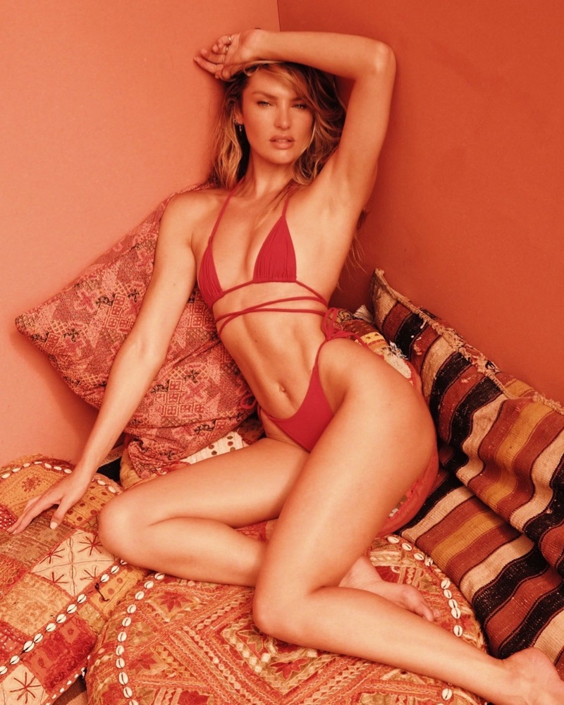 Looking red-hot, Candice Swanepoel wears Tropic of C Praia top and bottom.