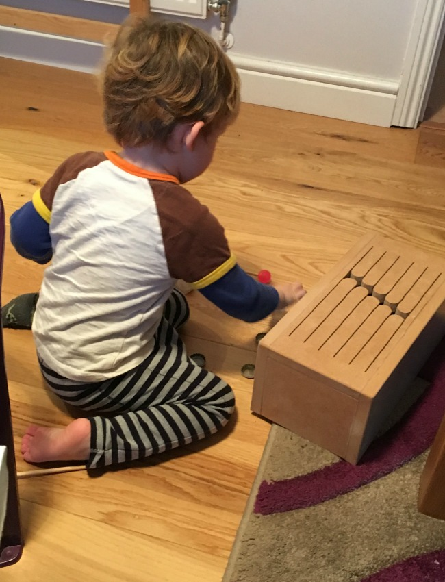 toddler-playing-with-box-drum