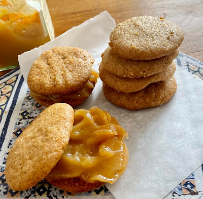 Stack of honey cookies, some with lemon curd