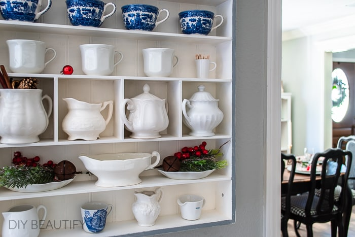 Christmas decorated wall cubby with ironstone