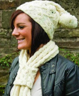 http://www.letsknit.co.uk/free-knitting-patterns/LK71-woolyknit-hat-scarf-set