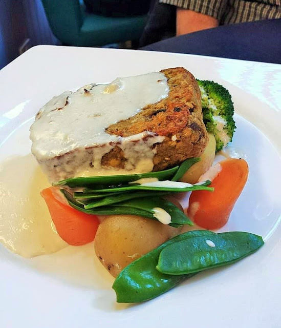 Lentil Loaf - a nut loaf made with vegetarian haggis and lentils served with vegetables and whisky sauce at the Atholl Arms Hotel in Dunkeld