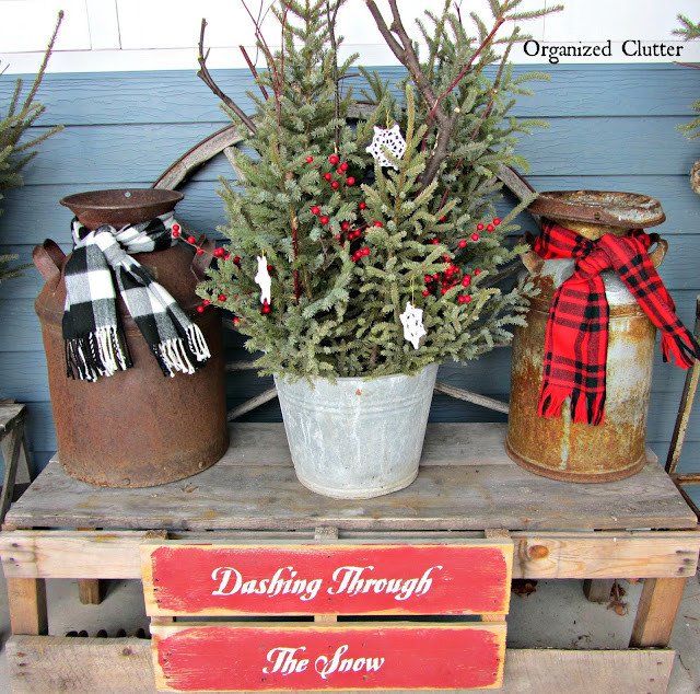 Covered Patio Outdoor Greenery Buckets #rusticChristmas #sprucetops