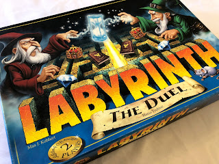 The box art from Labyrinth: The Duel, showing two wizards locked in battle.