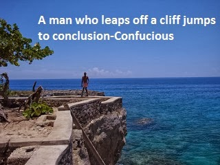 A picture of a man jumping of a cliff and with a Confucius quote.