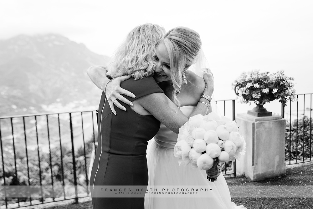 Bride hugging mother after ceremony