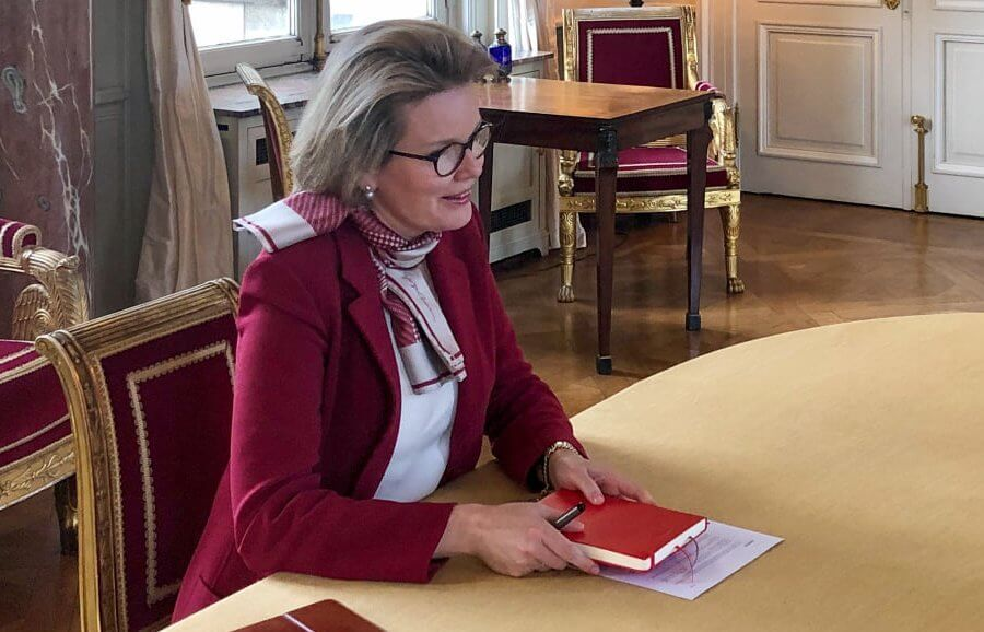 The Schwab Foundation for Social Entrepreneurship. Queen Mathilde wore a red blazer from Natan, and print silk satin scarf from Armani