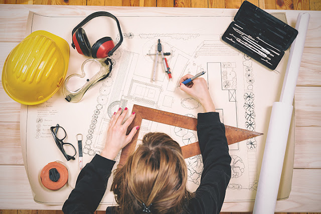 A female architect drafting a site plan