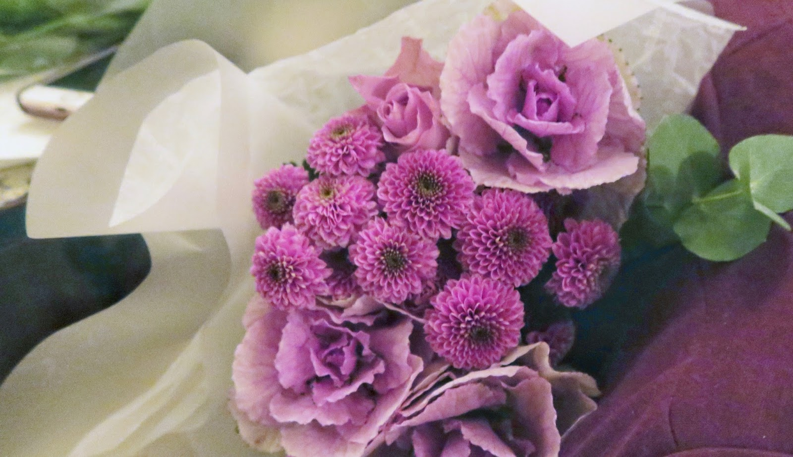 how to turn your day around when you're in a bad mood, on francescasophia.co.uk; a bunch of flowers in their wrapping; the flowers are pink, and are cabbage roses
