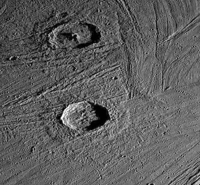 Crater Gula(top) and Achelous(botton) on the grooved terrain, captured by Galileo spacecraft