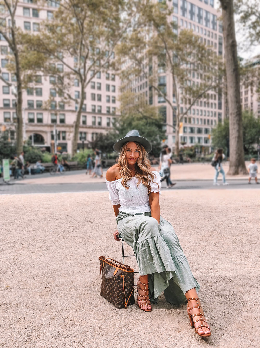 Oklahoma blogger Amanda Martin wearing a boho chic wide leg pant and white crop top while traveling in NYC