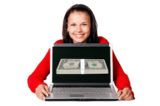 Female with dollars on lab-top