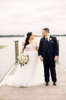 bride and groom smiling on deck